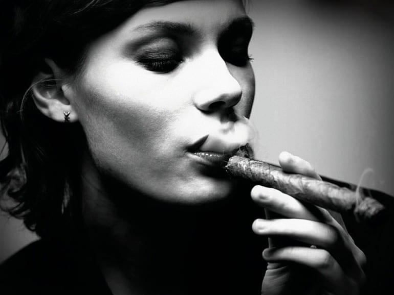 woman smoking cigar bw stock photo r