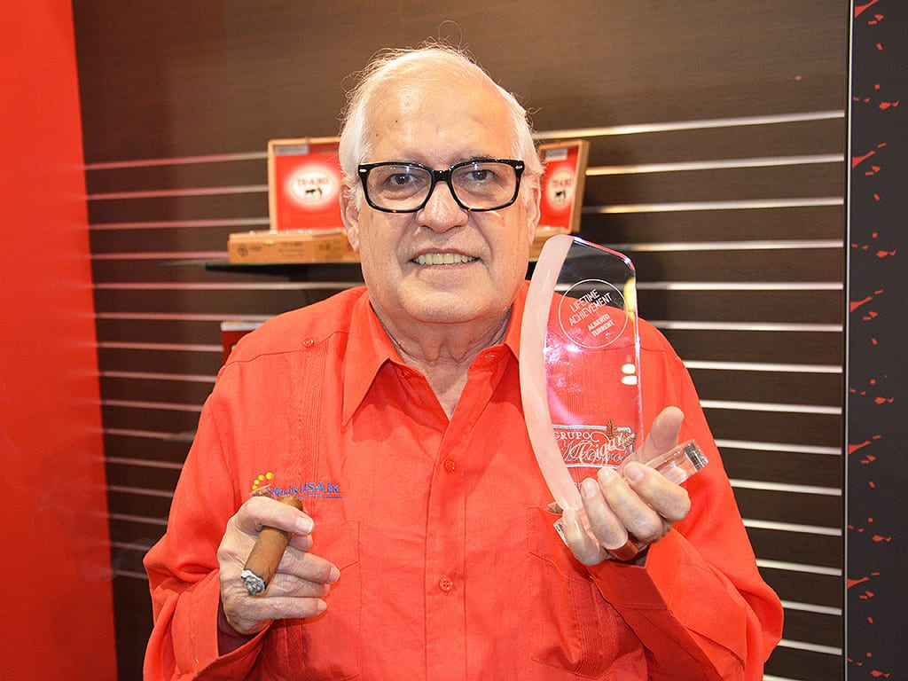 alberto turrent with cigar journal lifetime achievement award trophy 2014