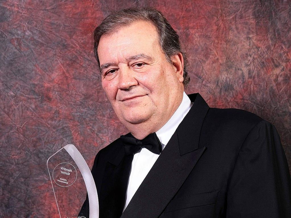 hendrik kelner portrait with cigar journal lifetime achievement award trophy 2013