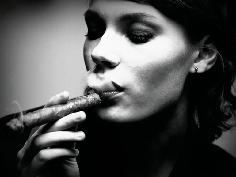 woman smoking cigar bw stock photo l