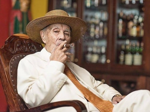 avo uvezian rocking chair smoking cigar