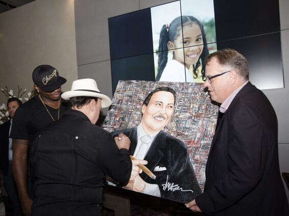 3.Carlito Fuente signing a painting by former Oklahoma City Thunder basketball player, Desmond Mason (now a professional artist)